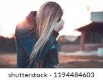 blond woman wearing jeans... | Shutterstock . vector #1194484603