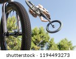 bmx rider performing a jump on... | Shutterstock . vector #1194493273