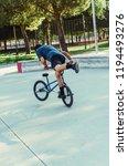 flatland bmx rider performing a ...   Shutterstock . vector #1194493276