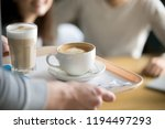 close up of waiter holding... | Shutterstock . vector #1194497293