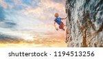 man rock climber with long hair.... | Shutterstock . vector #1194513256