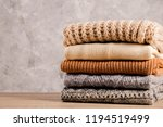 bunch of knitted warm pastel... | Shutterstock . vector #1194519499