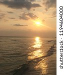 sunset over the beach.  | Shutterstock . vector #1194604000