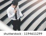 asian businessman standing on...   Shutterstock . vector #1194611299