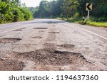 bad roads. hole in the asphalt  ... | Shutterstock . vector #1194637360