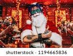 razy punk santa claus in... | Shutterstock . vector #1194665836