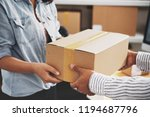 female post worker giving... | Shutterstock . vector #1194687796