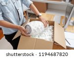 post office worker packing vase ... | Shutterstock . vector #1194687820