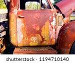vintage truck rusting in field   Shutterstock . vector #1194710140