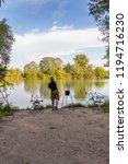 fisherman on a lake in carp... | Shutterstock . vector #1194716230