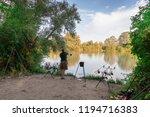 fisherman on a lake in carp... | Shutterstock . vector #1194716383