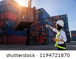 woman foreman control loading...   Shutterstock . vector #1194721870