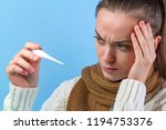 a sick young woman with a... | Shutterstock . vector #1194753376