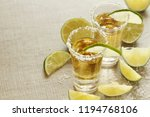 tequila shots with lime | Shutterstock . vector #1194768106