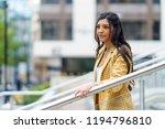 businesswoman walking down... | Shutterstock . vector #1194796810