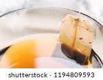 tea bag into glass cup full of ... | Shutterstock . vector #1194809593
