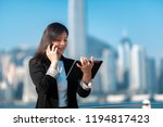 asian business woman on the... | Shutterstock . vector #1194817423