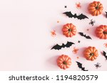 halloween decorations on pastel ... | Shutterstock . vector #1194820579