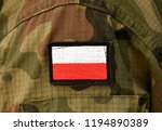 polish flag on soldier arm.... | Shutterstock . vector #1194890389