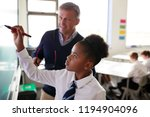male high school teacher with... | Shutterstock . vector #1194904096