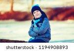happy cute boy outdoor in the... | Shutterstock . vector #1194908893