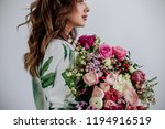 florist makes a bouquet. | Shutterstock . vector #1194916519