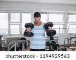 young attractive adult man... | Shutterstock . vector #1194929563