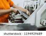close up shot of worker's hand... | Shutterstock . vector #1194929689