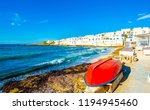 sunshine view of red boat and... | Shutterstock . vector #1194945460