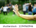 woman lifts hand up and show...   Shutterstock . vector #1194960946