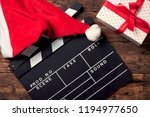 christmas hat with film board... | Shutterstock . vector #1194977650