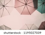colorful umbrellas in the sky.... | Shutterstock . vector #1195027039