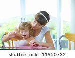 portrait of young woman feeding ... | Shutterstock . vector #11950732