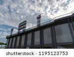 stadium floodlights against... | Shutterstock . vector #1195123753