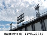 stadium floodlights against... | Shutterstock . vector #1195123756