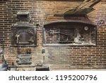 artisanal oven in operation of... | Shutterstock . vector #1195200796