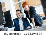 happy young business people...   Shutterstock . vector #1195294579