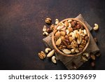 Assortment Of Nuts In Wooden...