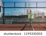 man playing padel in a orange... | Shutterstock . vector #1195330303