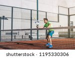 man playing padel in a orange... | Shutterstock . vector #1195330306