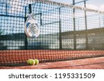 padel blade racket hanging on... | Shutterstock . vector #1195331509