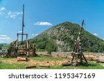 medieval trebuchets under... | Shutterstock . vector #1195347169