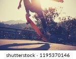 skateboarder skateboarding at... | Shutterstock . vector #1195370146