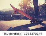 skateboarder skateboarding at... | Shutterstock . vector #1195370149