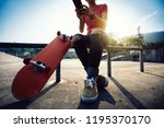 skateboarder use mobile phone... | Shutterstock . vector #1195370170