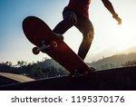 skateboarder skateboarding at... | Shutterstock . vector #1195370176