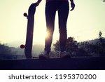 skateboarder skateboarding at... | Shutterstock . vector #1195370200