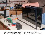 repair lcd tv  disassembly led... | Shutterstock . vector #1195387180