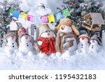 family of snowmen  in the... | Shutterstock . vector #1195432183