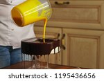 cook is preparing a mousse cake ... | Shutterstock . vector #1195436656